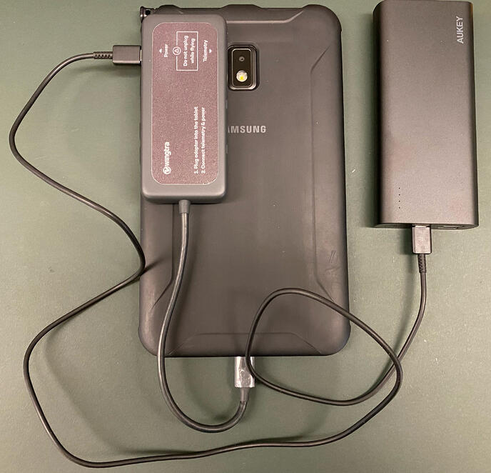 tablet connected to power bank